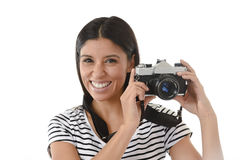 Woman taking pictures posing smiling happy using cool retro and vintage photo camera Royalty Free Stock Photo