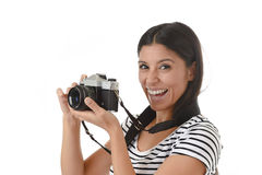 Woman taking pictures posing smiling happy using cool retro and vintage photo camera Royalty Free Stock Photos