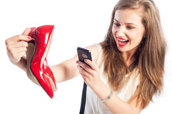 Woman taking pictures with red shoes Stock Image