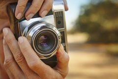 Woman taking pictures with vintage camera. Travel Royalty Free Stock Photo