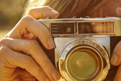Woman taking pictures with vintage camera. Travel Stock Photography