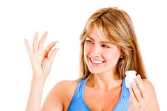 Woman taking a pill Royalty Free Stock Image