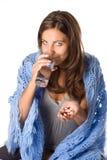 Woman taking pill Royalty Free Stock Image