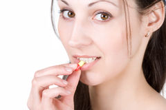 Woman taking pill Stock Image