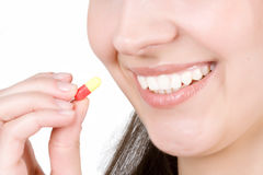 Woman taking pill Stock Photo