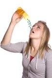 Woman taking pills Stock Photos