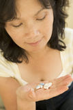Woman Taking Pills Stock Images