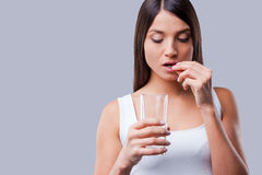 Woman taking pills. Stock Images