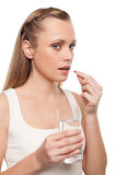 Woman taking pills. Royalty Free Stock Images