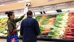 Woman taking plastic bag for buying foods in grocery store stock footage