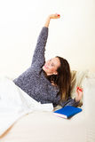 Woman taking power nap after lunch Royalty Free Stock Images