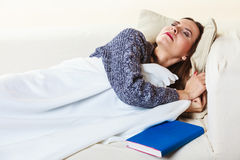 Woman taking power nap after lunch Stock Images