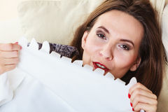 Woman taking power nap after lunch Stock Photo