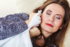 Woman taking power nap after lunch Royalty Free Stock Photo