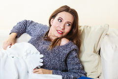 Woman taking power nap after lunch Royalty Free Stock Image