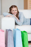 Woman taking a rest on the sofa after shopping tour Royalty Free Stock Photo