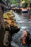 Woman taking a ritual bath at a local temple in bali Stock Photos