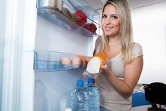 Woman Taking Sausage From Refrigerator Royalty Free Stock Photo