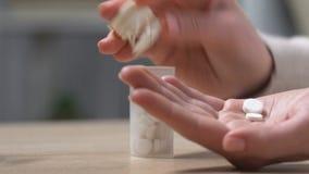 Woman taking sedatives, anti-anxiety drugs, treatment of postnatal depression. Stock footage stock footage
