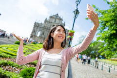 Woman taking self image with Saint Paul's Cathedral in Macau Royalty Free Stock Images
