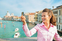 Woman taking self photo in venice, italy Stock Images