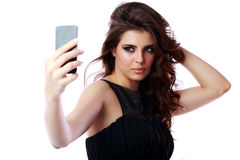 Woman taking self picture with smartphone Stock Photos