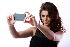 Woman taking self picture with smartphone Stock Photo