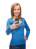 Woman taking self picture with smartphone camera Stock Photo