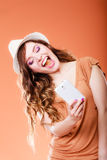 Woman taking self picture with smartphone camera. Technology internet and happiness concept. Happy summer woman taking self picture selfie with smartphone camera Royalty Free Stock Photos