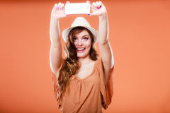 Woman taking self picture with smartphone camera Royalty Free Stock Photo