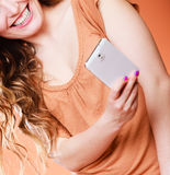 Woman taking self picture with smartphone camera Stock Images