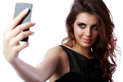 Woman taking self picture with smartphone Stock Photography