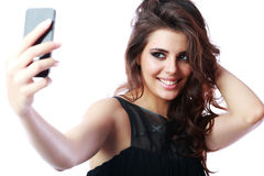 woman taking self picture with smartphone Royalty Free Stock Image