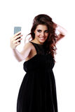 Woman taking self picture with smartphone Royalty Free Stock Photos