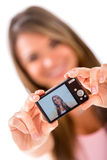 Woman taking a self portrait Royalty Free Stock Images