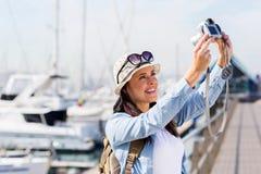 Woman taking self portrait Royalty Free Stock Photos