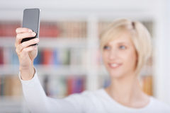 Woman Taking Self Portrait Through Mobile Phone Royalty Free Stock Photos