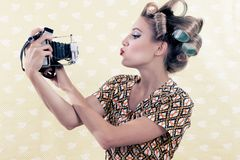 Woman taking Self-portrait Stock Images