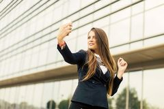 Woman taking a selfi with mobile phone Royalty Free Stock Images