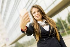 Woman taking a selfi with mobile phone Royalty Free Stock Image