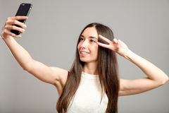Woman taking selfie Royalty Free Stock Images