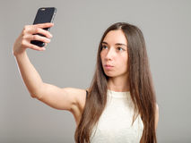 Woman taking selfie Royalty Free Stock Photography