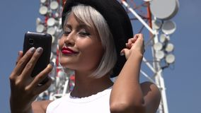 Woman Taking Selfie At Cell Tower stock video