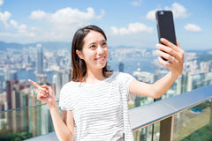 Woman taking selfie by cellphone Royalty Free Stock Photography