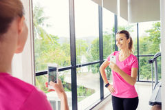 Woman taking selfie in gym. Fitness lifestyle. Pretty young woman taking selfie in gym Royalty Free Stock Photography