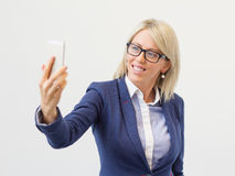 Woman taking selfie with her mobile phone Stock Photo
