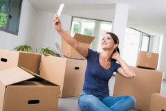 Woman taking a selfie in her new house Royalty Free Stock Photo