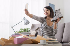 Woman taking a selfie with her new purchases Royalty Free Stock Photography