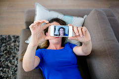 Woman taking a selfie on her phone Stock Image