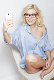 Woman taking selfie at home Stock Image